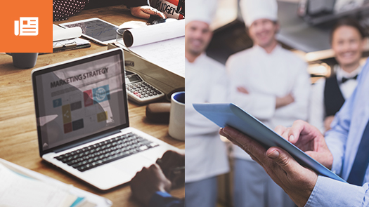laptop on table, chefs in kitchen